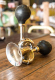Vintage brass bicycle horn on wooden Table Stock Photos