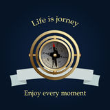 Vintage brass compass and blue ribbon. Life is jorney. Stock Images