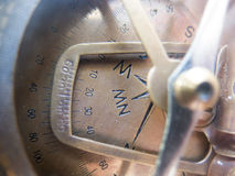 Vintage brass compass dial closeup. Directions large ancient old compass Stock Image