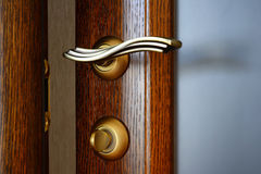 Vintage Brass Door Handle With A Latch And A Lock. Royalty Free Stock Images