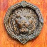 Vintage brass door knocker - lion head. Decorative detail on the front door royalty free stock photography