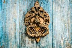 Vintage brass door knocker on wooden door Royalty Free Stock Image