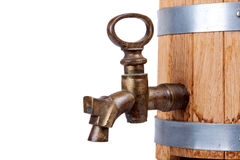 Vintage brass faucet in an old oak barrel isolated Royalty Free Stock Images
