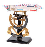 Vintage brass letter scale with a pile of letters. On the top plate for weighing to calculate the postage payable on the double numbered scales below, isolated Royalty Free Stock Photo