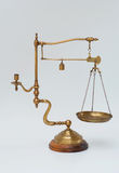 Vintage brass scale with weight and candleholder stock photos