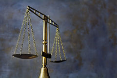 Vintage brass scales of justice against a dark rustic background Stock Images