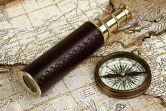 Vintage brass telescope. On antique map Stock Photos