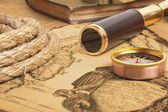 Vintage brass telescope. On antique map Stock Image