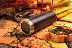 Vintage brass telescope. On antique map Stock Photography