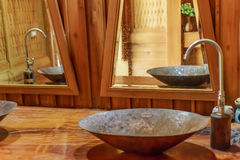 Vintage brass wash basin in wooden bathroom. Royalty Free Stock Photography