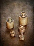 Vintage brass weights. Distressed texture for a retro feel.Focus on the 20 grams weight stock photography
