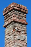 Vintage brick chimney Stock Images