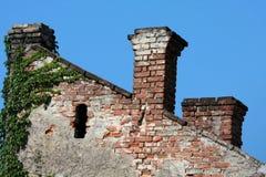 Vintage brick chimneys stock images