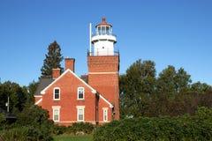 Vintage brick lighthouse stock photo