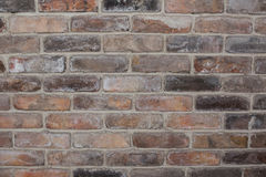 Vintage brick wall, old texture of red stone blocks closeup.  Stock Photo