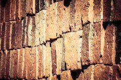 Vintage brick wall rusty colored abstract background. Royalty Free Stock Photos