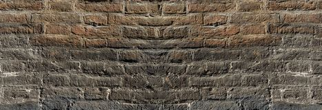 Vintage brick wall texture in contrast lighting for design. Panoramic background for text and image.  royalty free stock photo