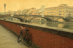 Vintage bridge on the river in Florence , Italy Royalty Free Stock Images
