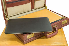 Vintage briefcase with laptop Stock Photography