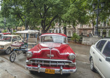 A vintage bright red car parked in Havana Cuba Stock Photo