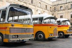 Vintage british bedford buses on street of la valletta malta. Vintage orange british bedford buses on street of la valletta old town malta Royalty Free Stock Image