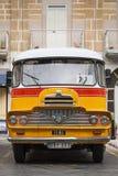 Vintage british bedford buses on street of la valletta malta. Vintage orange british bedford buses on street of la valletta old town malta Stock Photo