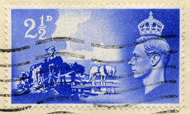 Vintage British Postage Stamp with King George VI. UNITED KINGDOM - CIRCA 1948: A vintage British postage stamp celebrating the liberation of the Channel Islands Stock Images