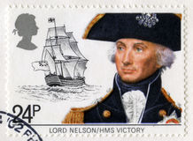 Vintage British Postage Stamp of Lord Nelson. UNITED KINGDOM - CIRCA 1983: A vintage British postage stamp featuring a portrait of Lord Nelson and HMS Victory Royalty Free Stock Image