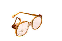 Vintage and broken eyeglasses isolated on white Royalty Free Stock Images