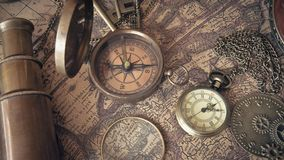 Vintage Bronze Compass With Old Collection. On Old World Map royalty free stock photography