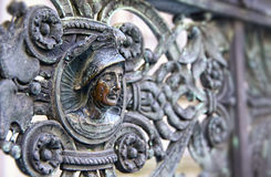 Vintage bronze fence with human head Stock Photo