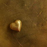 Vintage bronze heart with empty space on golden background Stock Photo