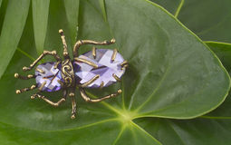 Vintage brooch with gems. Vintage brooch with lilac gems on leaves Stock Photo