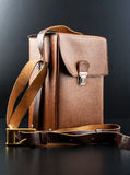Vintage brown briefcase. On black background Royalty Free Stock Image