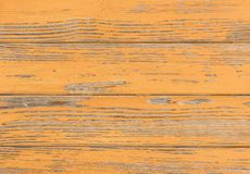 Vintage brown colored wood surface with peeled paint. Old brown colored wood boards planks background texture, horizontal view, close-up royalty free stock image