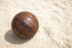 Vintage Brown Football Soccer Ball Sand Beach Background. Vintage brown football soccer ball sits on sand beach background in Rio de Janeiro Brazil stock photos
