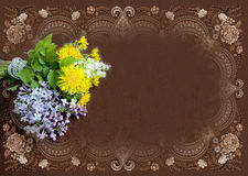 Vintage brown frame with dandelions, branch of lilac and lily of Royalty Free Stock Images