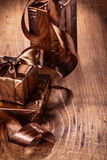 Vintage brown gift boxes with bows on old wooden Stock Image