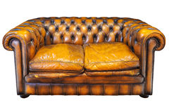 Vintage brown leather Chesterfield sofa isolated on white Royalty Free Stock Image