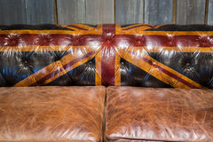 Vintage brown leather sofa with England flag texture Royalty Free Stock Image