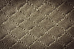 Vintage brown leather texture with diamond pattern Stock Photos