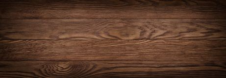 Vintage brown old rustics grunge wood texture, wooden surface ba. Dark brown scratched wooden cutting board. Wood texture stock photos
