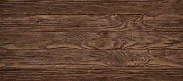 Vintage brown old rustics grunge wood texture, wooden surface ba. Dark brown scratched wooden cutting board. Wood texture stock image