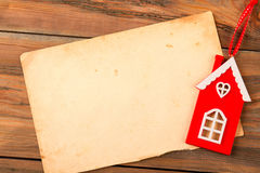 Vintage brown paper and red wooden house on the old background. Stock Photography