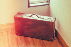 Vintage brown suitcase  ( Filtered image processed vintage effec Stock Images