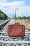 Vintage brown suitcase on the railway Royalty Free Stock Photography
