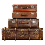 Vintage brown suitcases. Pile of vintage suitcases isolated on white background. Vintage travel luggage Royalty Free Stock Photo