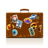 Vintage brown threadbare suitcase with collection of retro grung Stock Photography