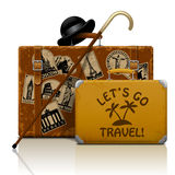 Vintage brown threadbare suitcase with collection of retro grung Royalty Free Stock Images