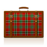 Vintage brown threadbare suitcase with tartan ornament  Royalty Free Stock Image